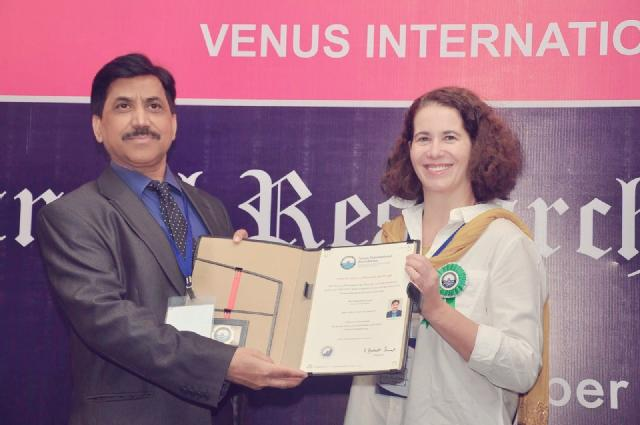 Prof Syed Javaid Zaidi recieving The Venus International Research Award for lifetime achievement