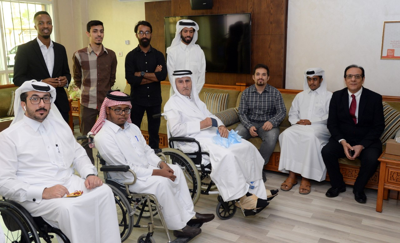 Photo of special needs students and special needs center staff with the elderly residents in Ehsan